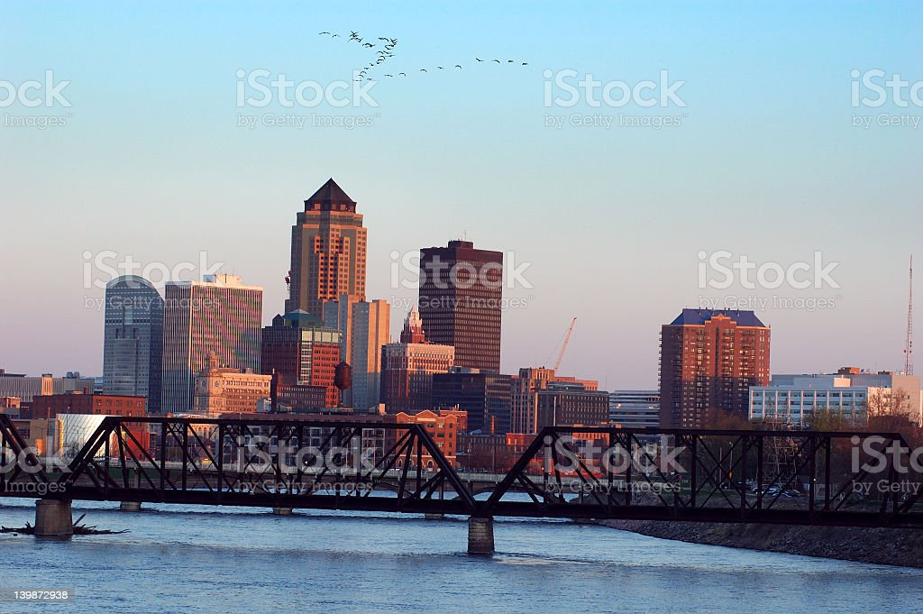 Skyline and Des Moines River in Des Moines, Iowa at sunset stock photo