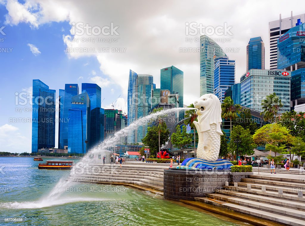 Skyline and Merlion statue at Merlion Park in Singapore stock photo