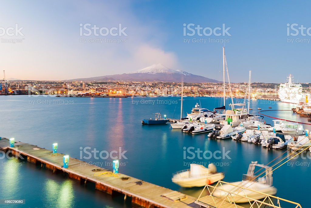 Skyline of Catania with volcano Etna after the sunset stock photo