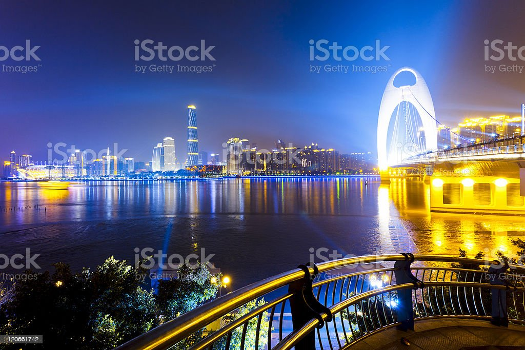 skyline of city at night stock photo