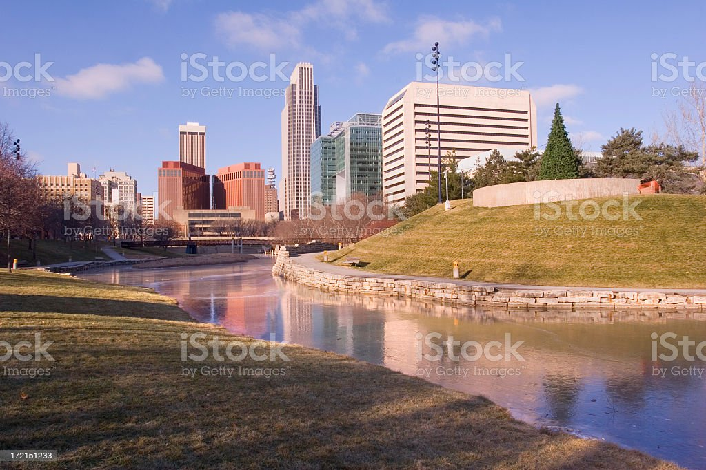 Skyline of city behind public park with water royalty-free stock photo