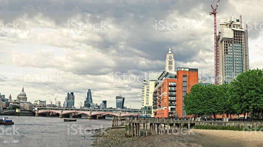 Skyline of City of London with Blackfriars Bridge stock photo