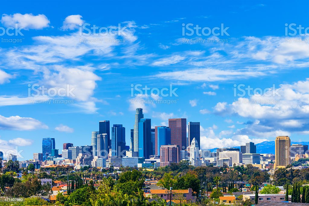 Skyline of downtown Los Angeles, CA against a blue sky stock photo