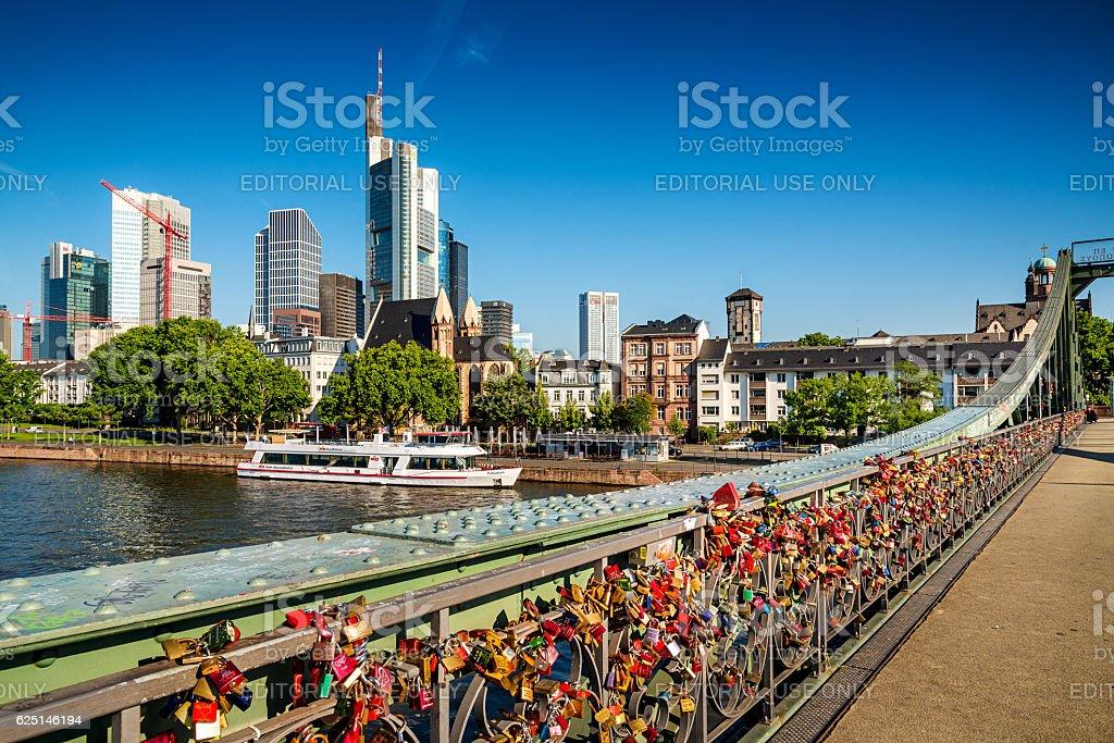 Skyline of Frankfurt am Main, Germany and love padlocks stock photo