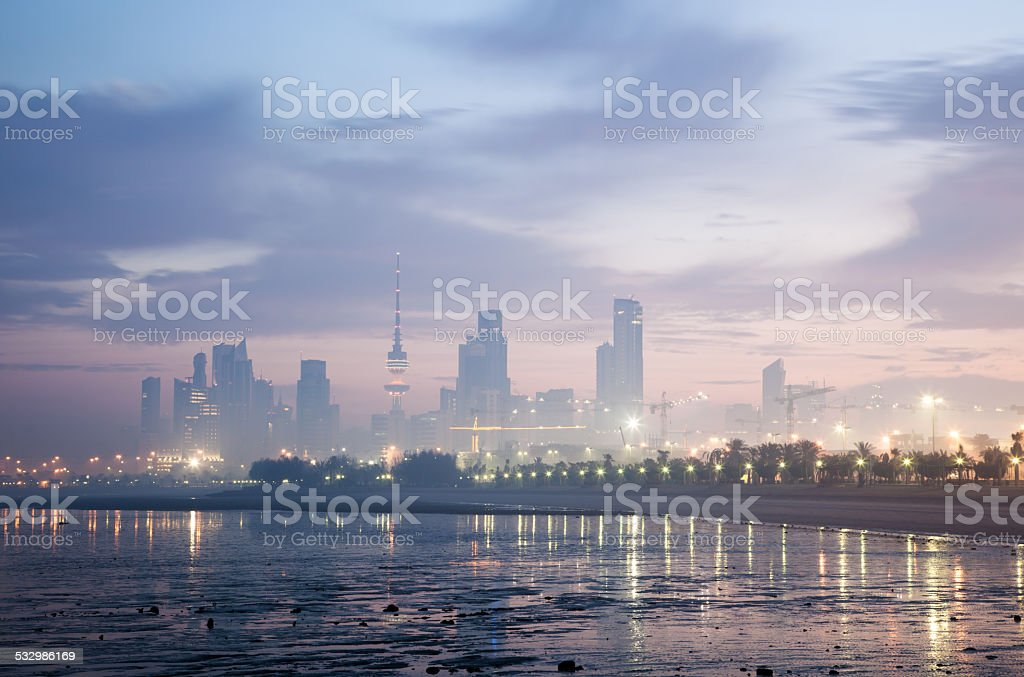 Skyline of Kuwait City at dawn stock photo