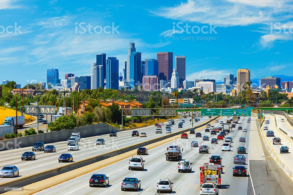 Skyline of Los Angeles with freeway traffic,CA stock photo
