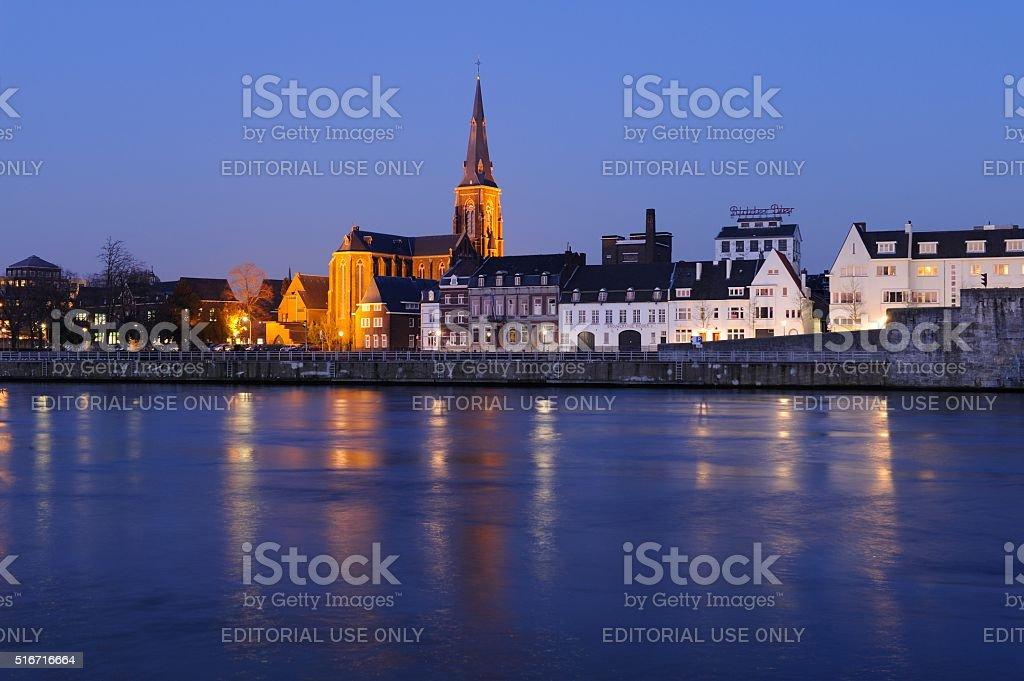 Skyline of Maastricht at night stock photo