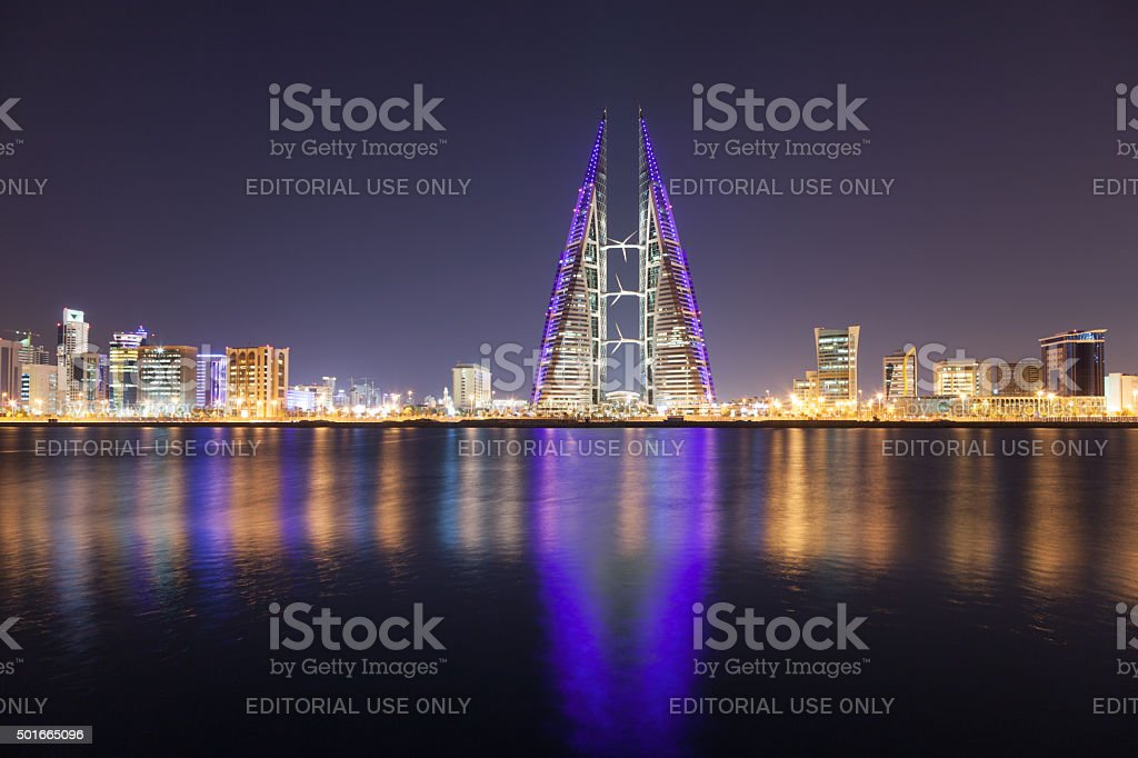 Skyline of Manama at night, Bahrain stock photo