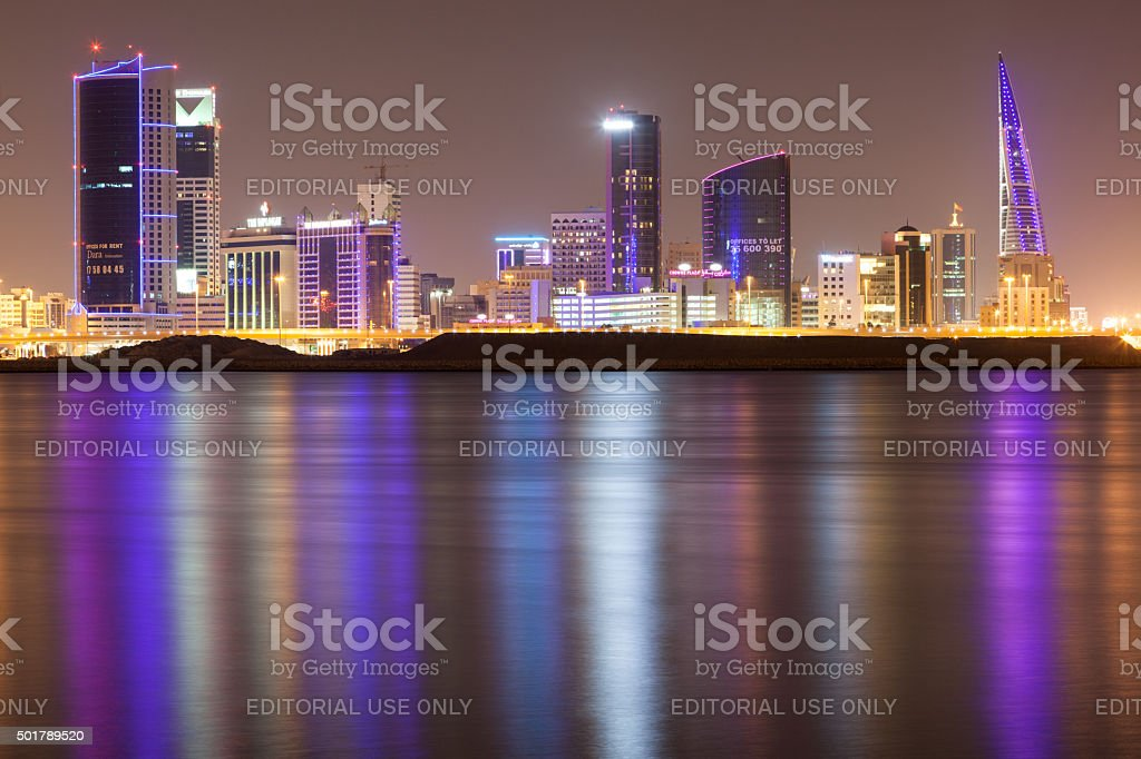 Skyline of Manama City at night stock photo