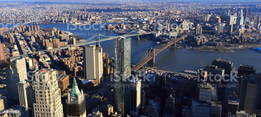 Skyline of Manhattan with Brooklyn bridge stock photo