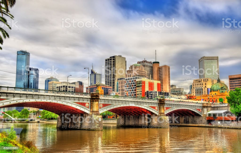 Skyline of Melbourne along the Yarra River and Princes Bridge stock photo