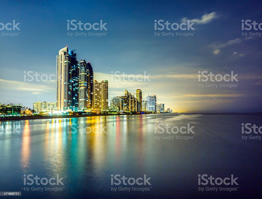 skyline of Miami sunny isles by night with reflections stock photo