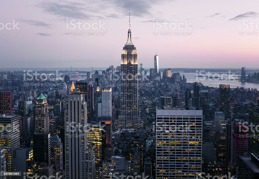 Skyline of Midtown Manhattan in New York City at night stock photo