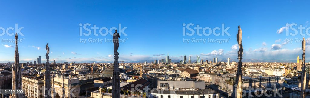 skyline of milan from famous Milan Cathedral under blue sky