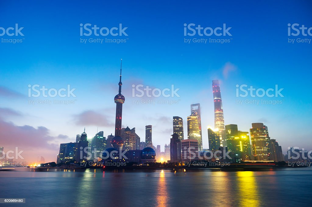 skyline of modern city with sunrise in shanghai stock photo