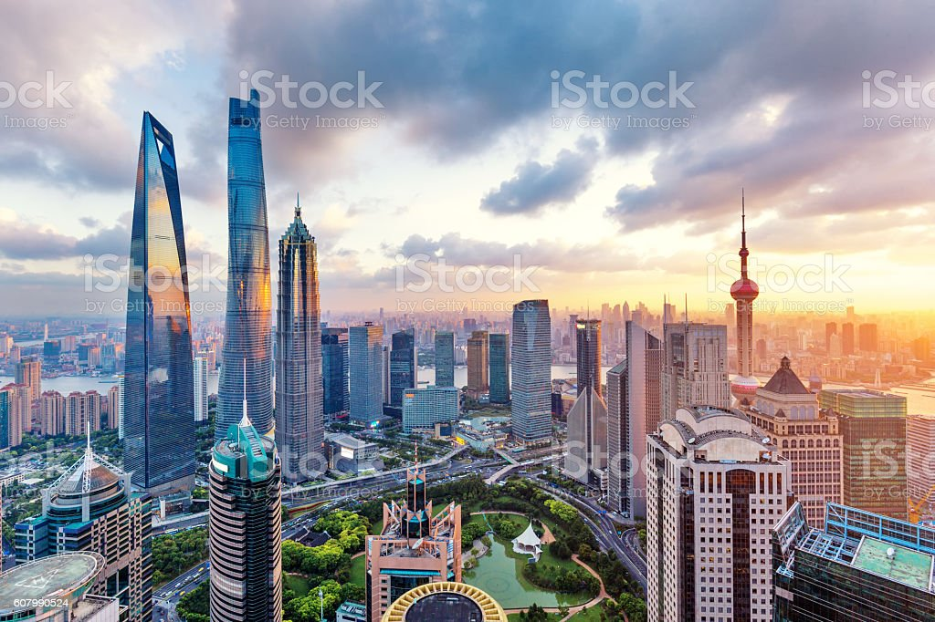 skyline of modern city with sunset in shanghai stock photo