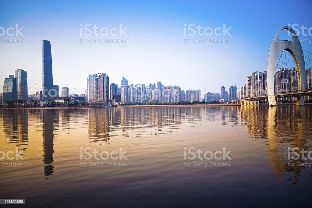 Skyline of modern urban city at sunset stock photo