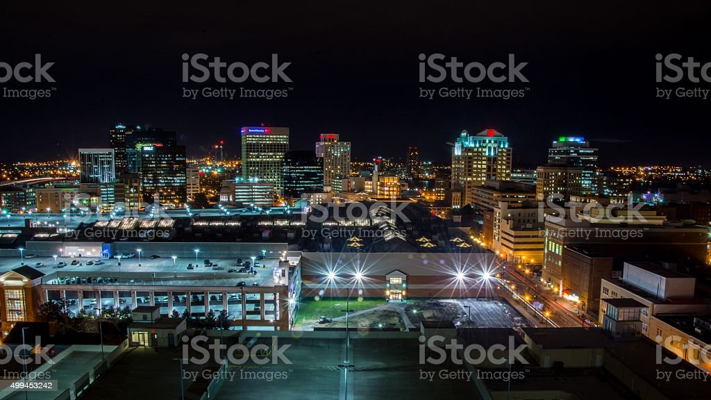 Skyline of Norfolk Virginia at night stock photo