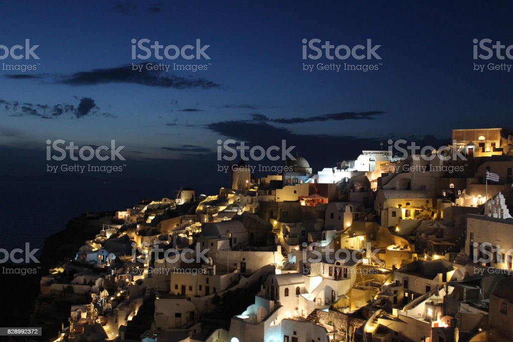 Skyline of Oia, the greek village of Santorini, Greece. Santorini is island, a famous vacation spot. stock photo