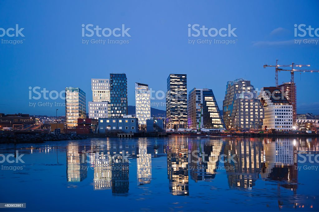 Skyline of Oslo at night reflecting in water. stock photo