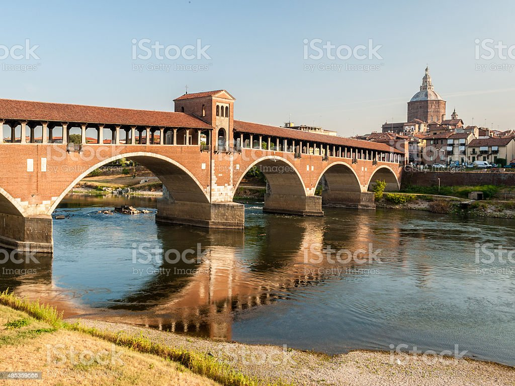 Skyline of Pavia, with 'Ponte Coperto' over the river Ticino stock photo