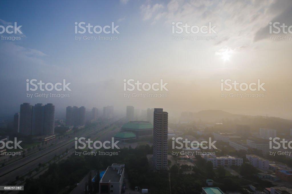Skyline of Pyongyang with sun stock photo