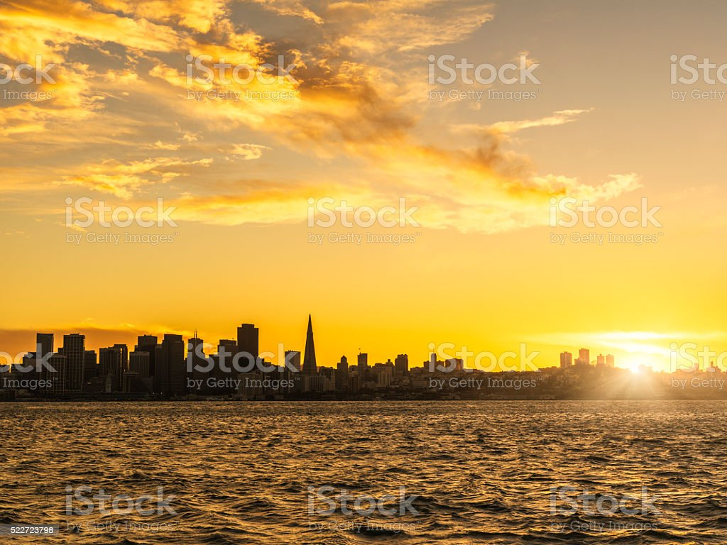 skyline of San Francisco at sunset stock photo