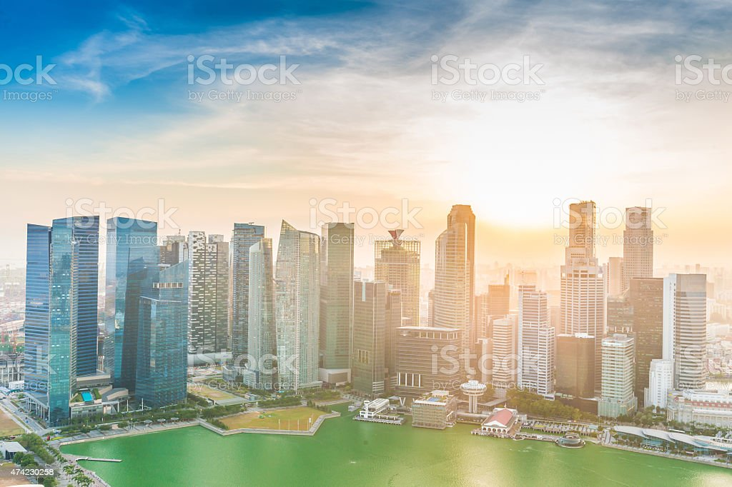 Skyline of Singapore business district at sunset stock photo
