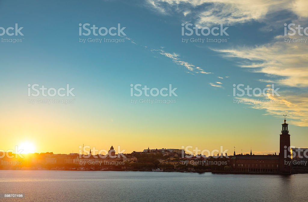 Skyline of Stockholm with town hall at sunset (Sweden) stock photo