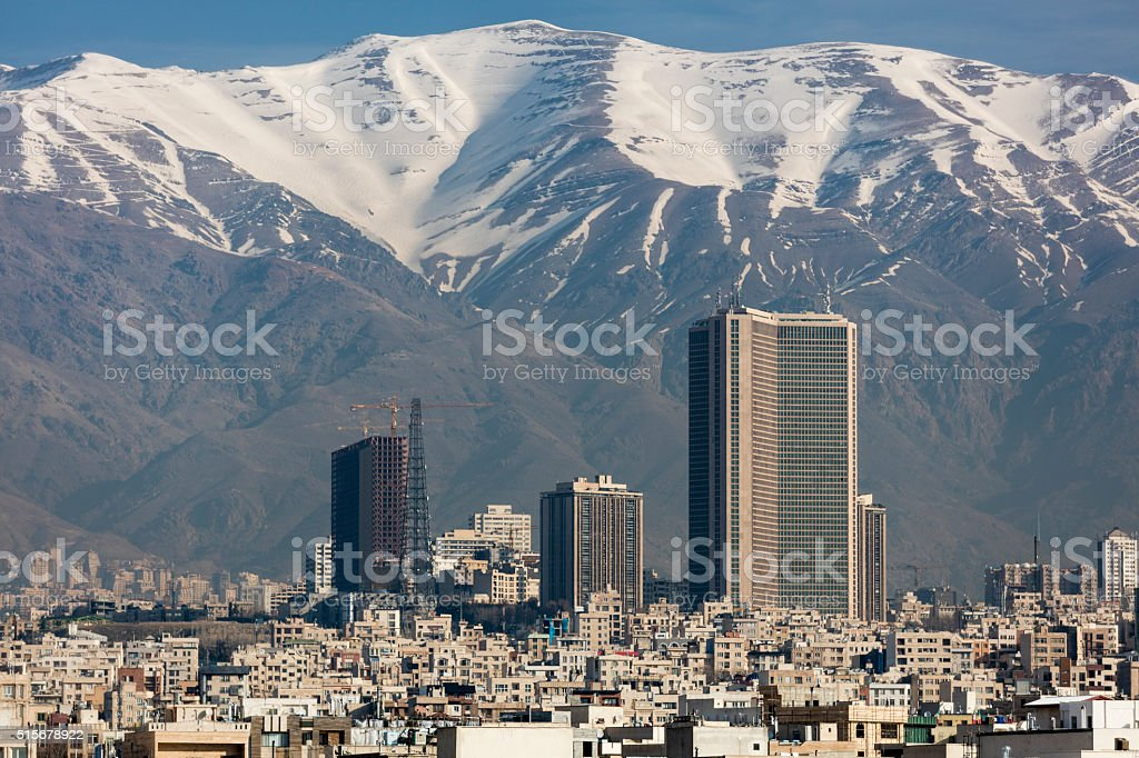 Skyline of Tehran below the snow-capped Alborz Mountains stock photo