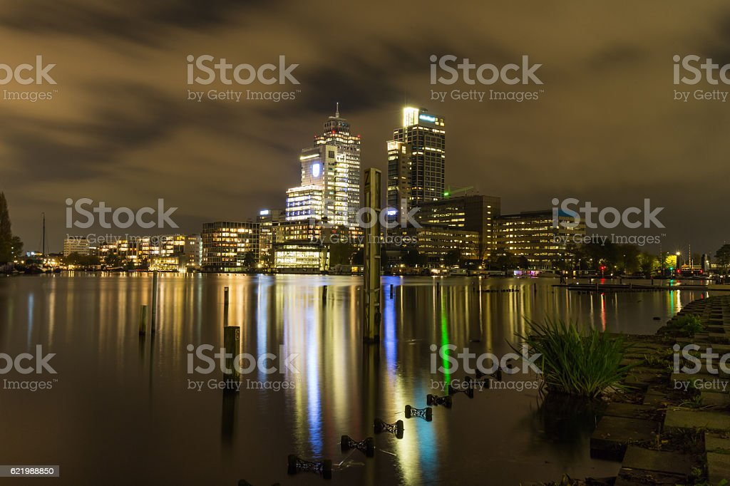 Skyline of the Amsterdam city center by night stock photo