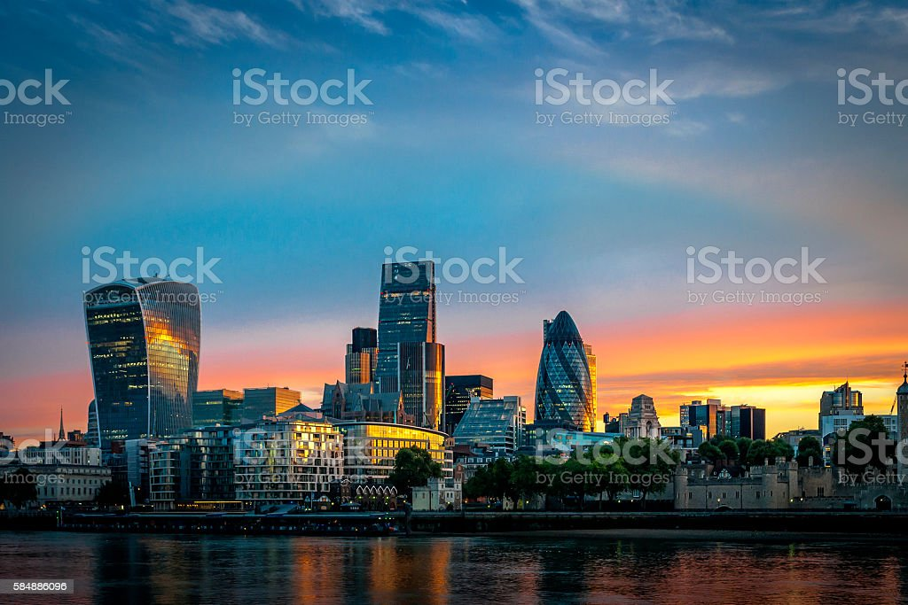 Skyline of The City in London, England at sunrise stock photo