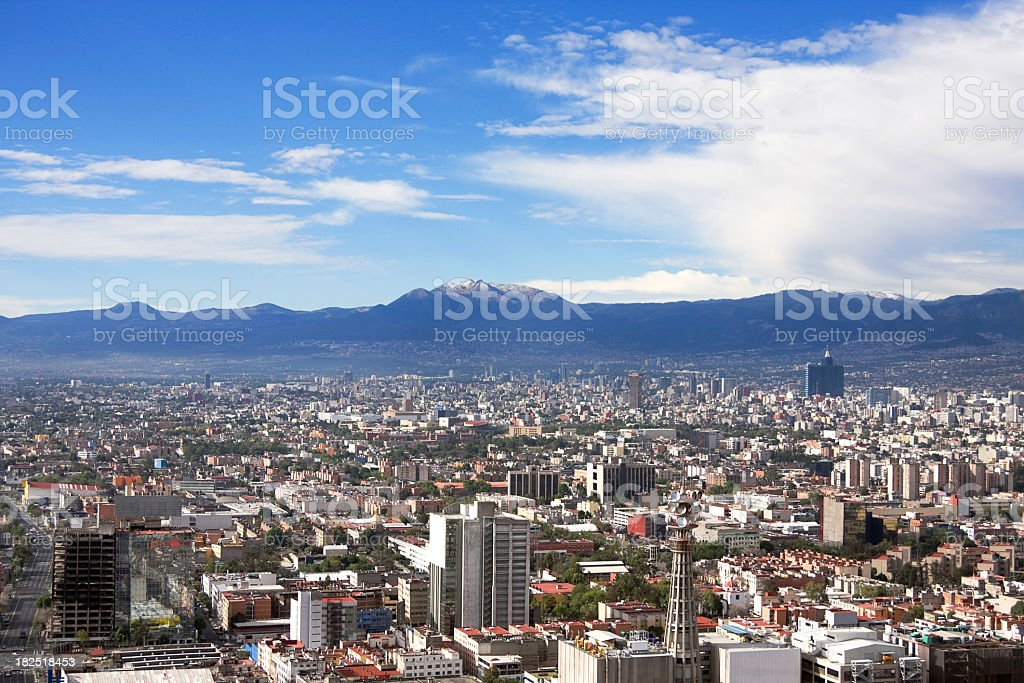 Skyline view of Mexico City on a sunny day royalty-free stock photo