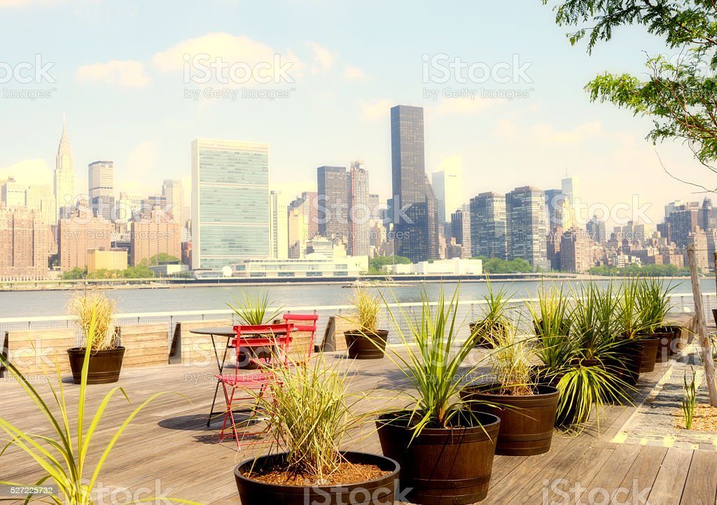 NYC Skyline with United Nations Building from a Sidewalk Cafe stock photo