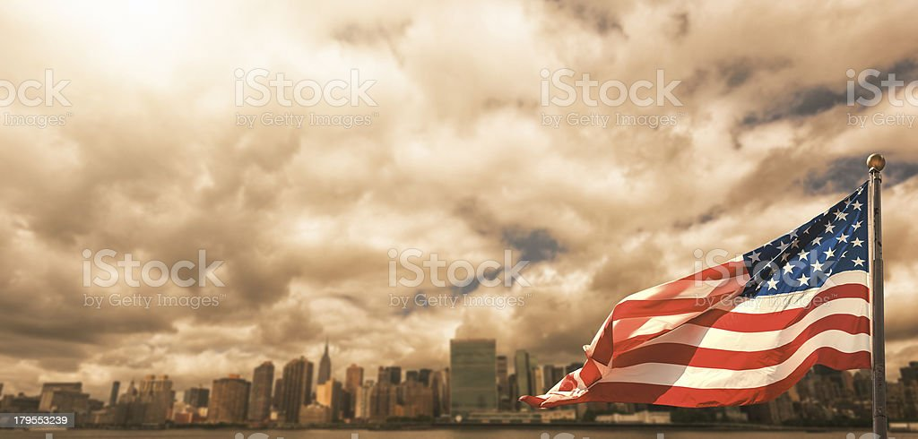 NYC skyline with us flag waving royalty-free stock photo
