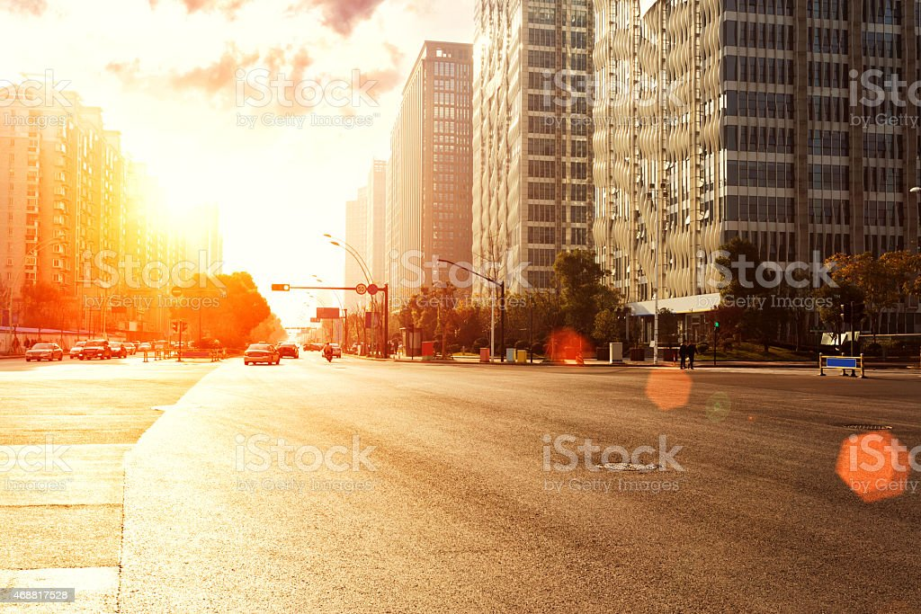 skyline,urban road and office buildings at sunset stock photo