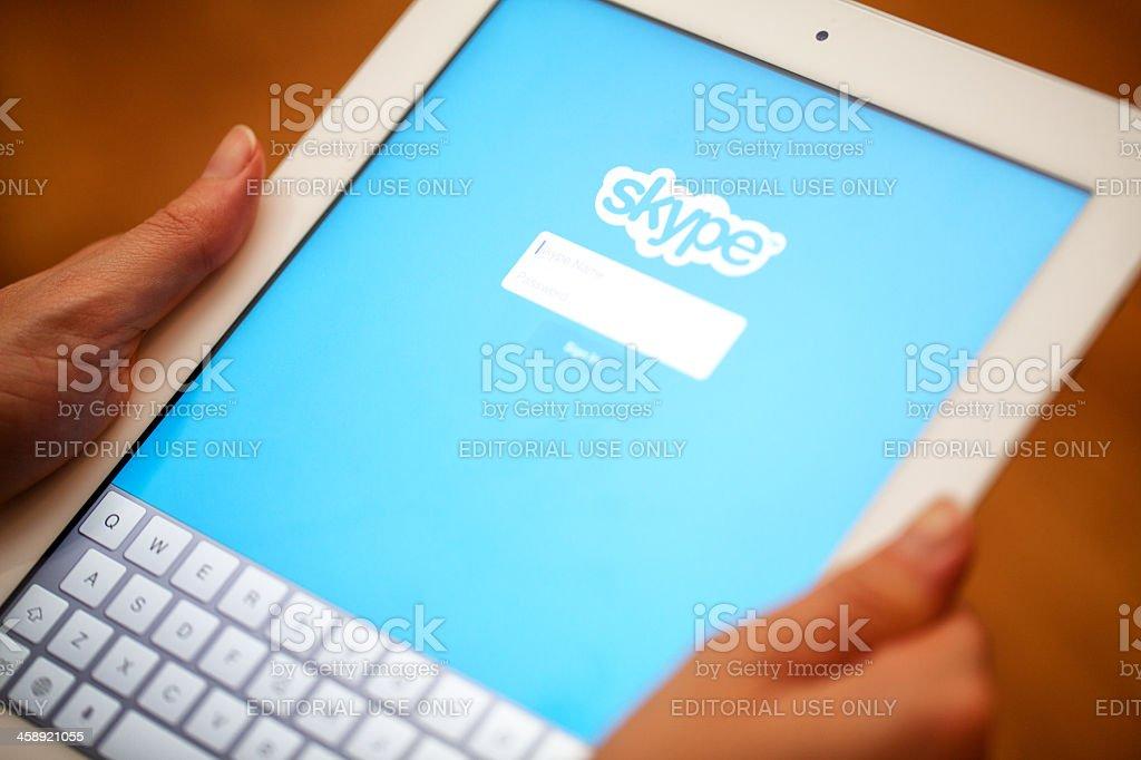 Skype apllication displayed Apple iPad. stock photo