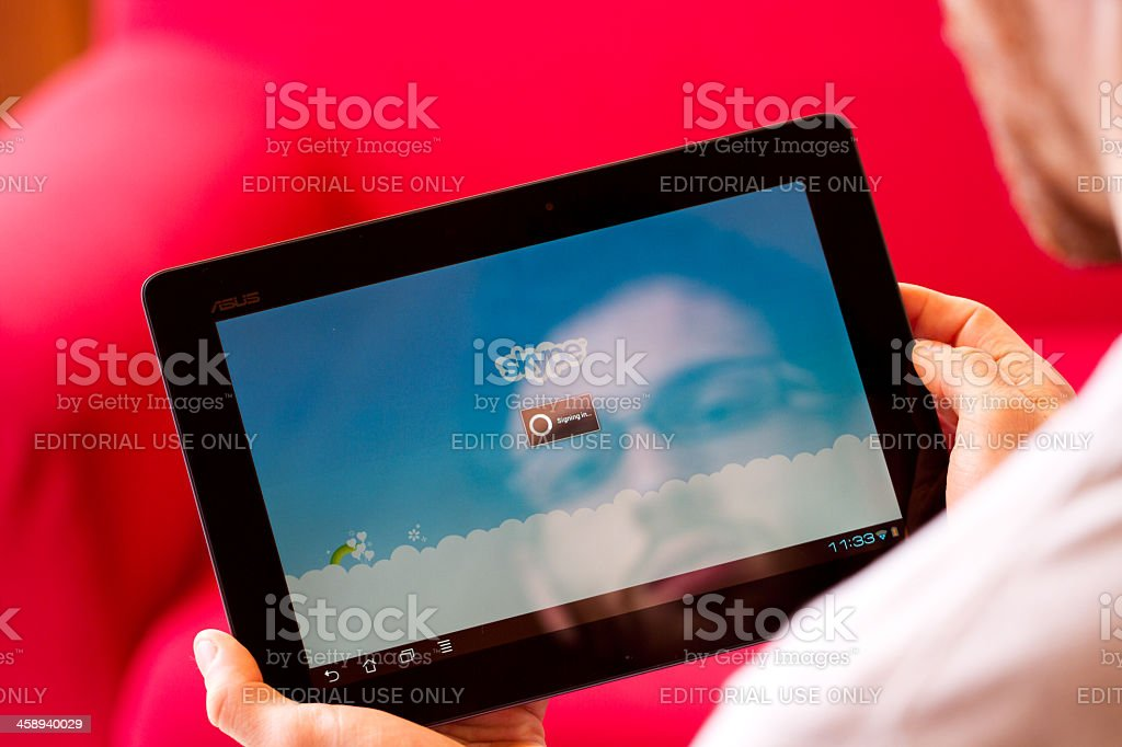 Skype apllication displayed on an tablet. stock photo