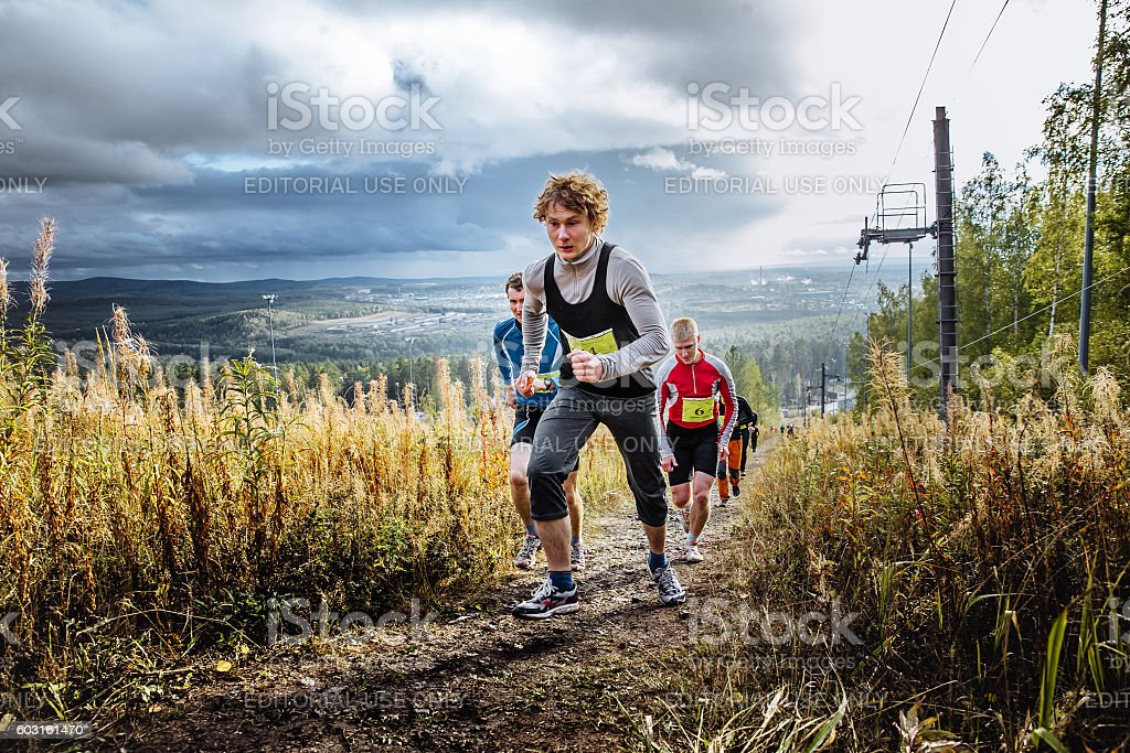 skyrunning group of runners running uphill on blue sky background royalty-free 스톡 사진