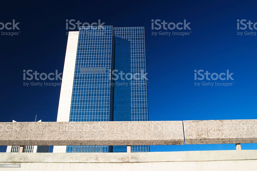 Skyscraper against stark blue sky royalty-free stock photo