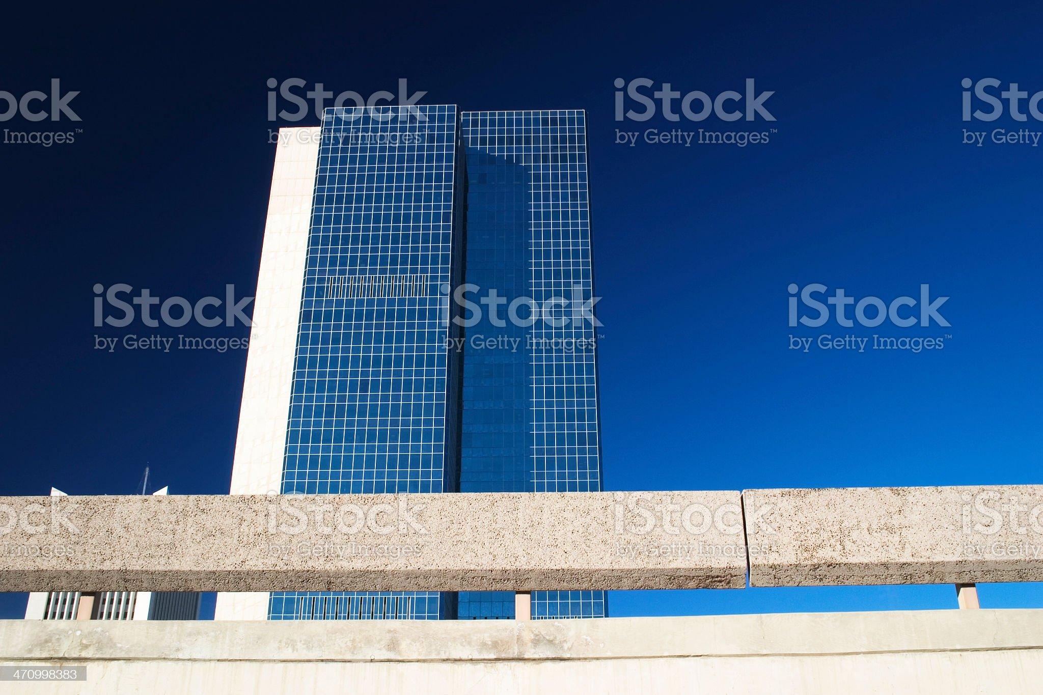 Skyscraper against stark blue sky royalty-free stock photo