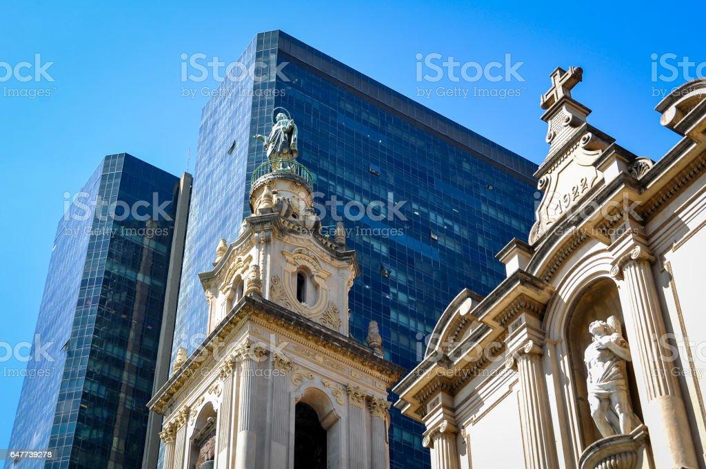 Skyscraper and Church stock photo