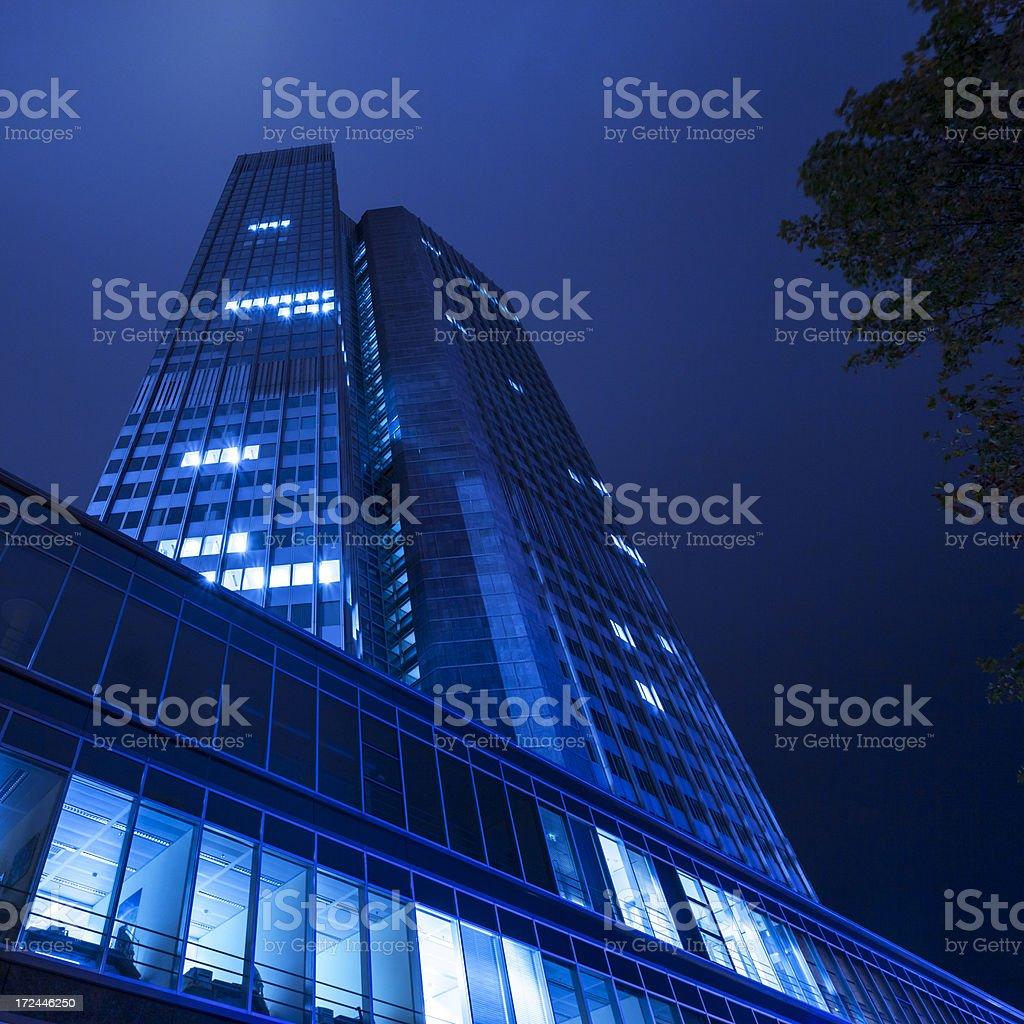 Skyscraper at night, blue toned, Frankfurt, Germany royalty-free stock photo