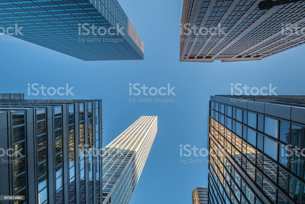 Skyscraper glass and steel canyons in midtown Manhattan, NYC stock photo