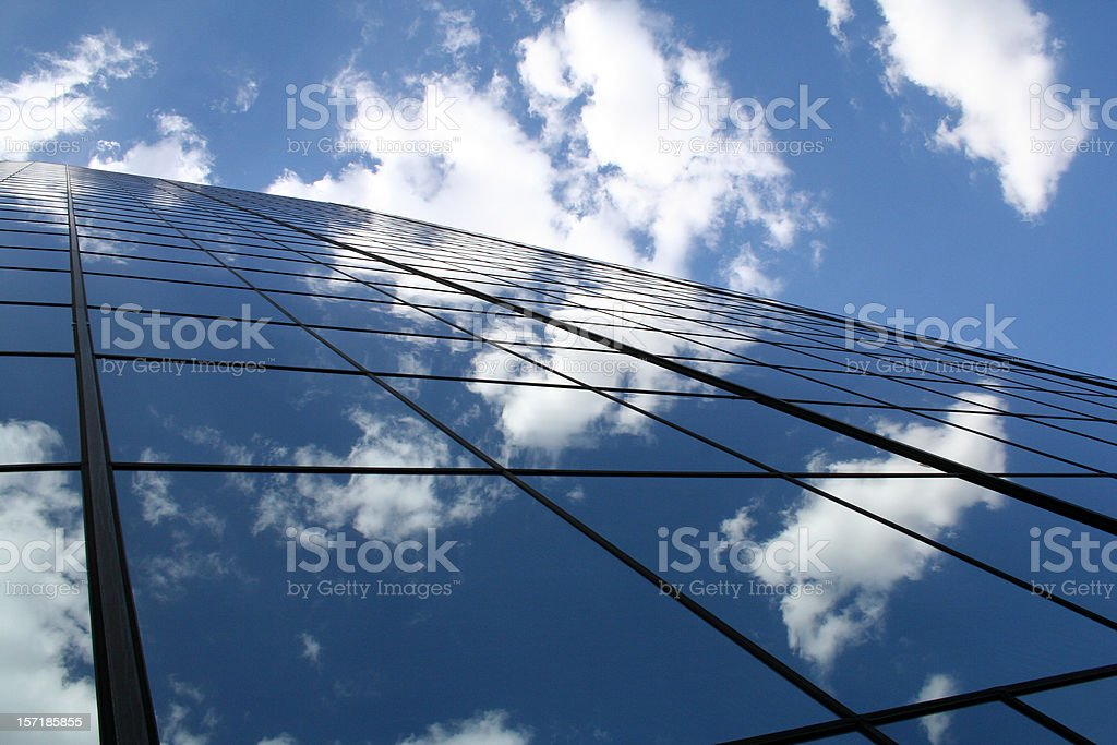 Skyscraper Reflecting The Cloud In Its Mirrored Walls royalty-free stock photo