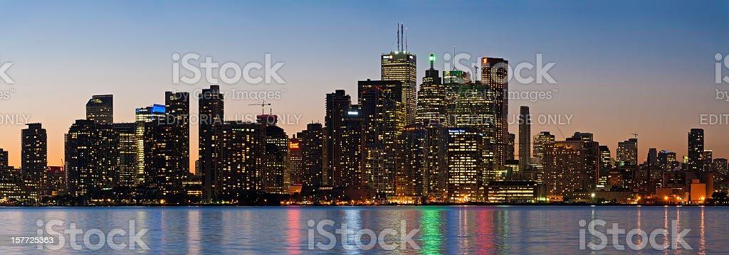Skyscraper skyline illuminated city lights reflecting panorama Toronto Canada stock photo
