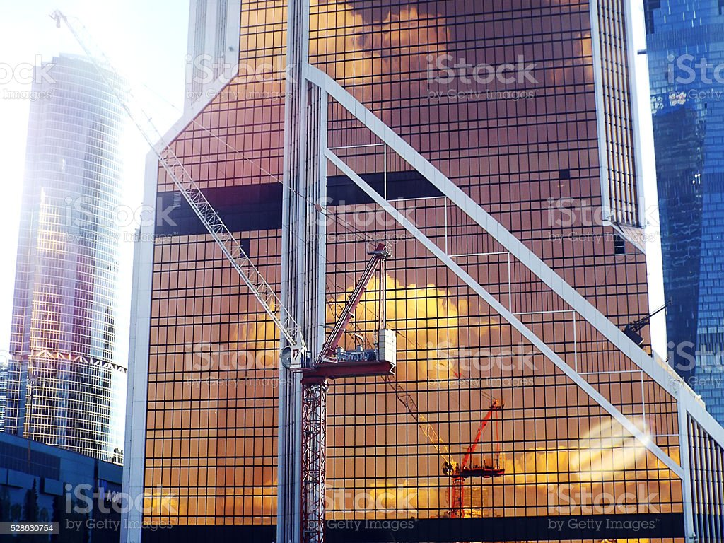 skyscraper under construction with crane stock photo