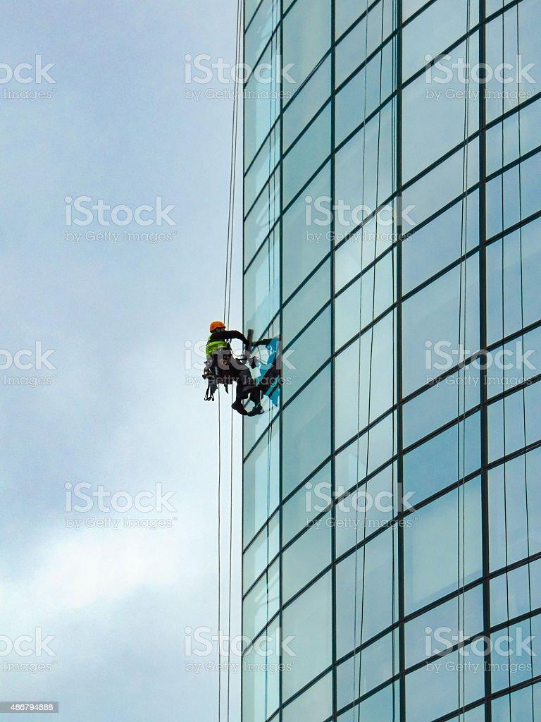 Skyscraper Window Cleaner on edge stock photo