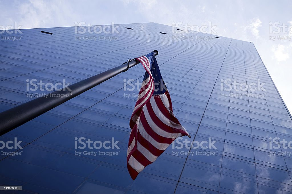 Skyscraper with American flag royalty-free stock photo