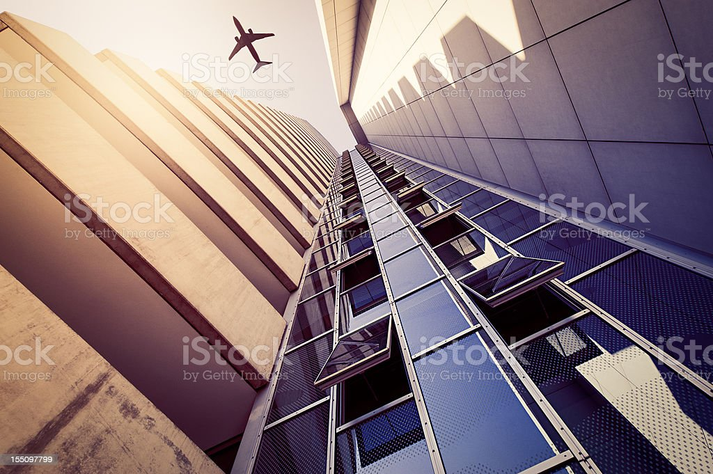 Skyscraper with an airplane silhouette royalty-free stock photo